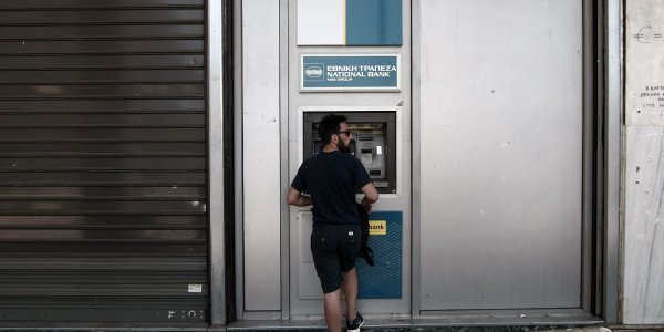 Greek banks to charge more for ATM cash withdrawals with other banks' cards